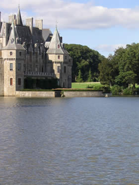 Chateau surrounded by golf course with lake in front. Missillac, Pays de la Loire