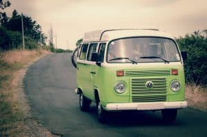 Green combi van on road