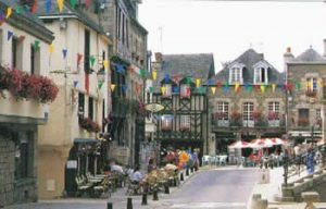 Josselin town centre with half-timbered buildings, street cafes
