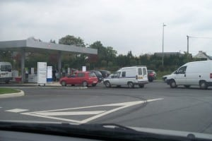 Cars queuing up to refill at a French service fuel station