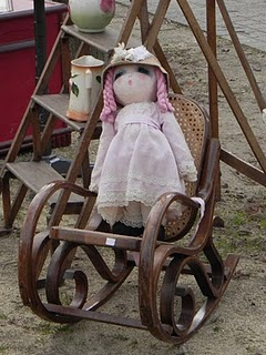 Doll in rocking chair at French brocante