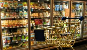 Fresh produce aisle in chilled cabinet in supermarket-shopping trolley