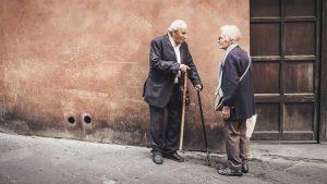 2 old men talking-wall-wooden door