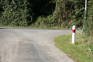 French road signs - white post with a red band