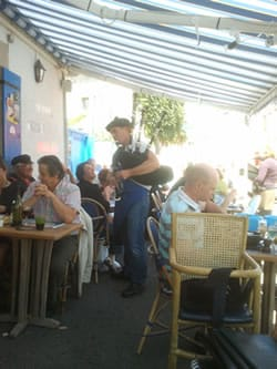 Bagpipe playing restaurant owner in Piriac-sur-Mer