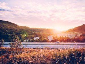 Car on motorway at sunset