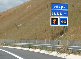 Peage sign ahead of French toll booths