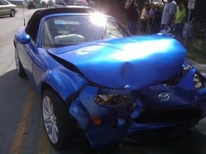smashed blue sports car